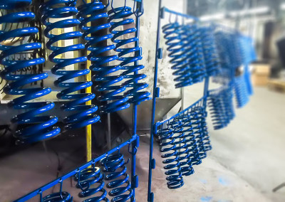 Blue Powder Coated Springs on Conveyor